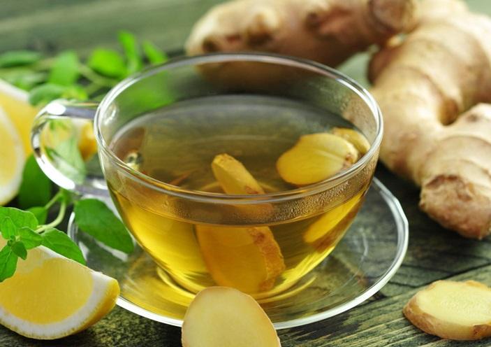 uống trà gừng giảm đau bụng kinh